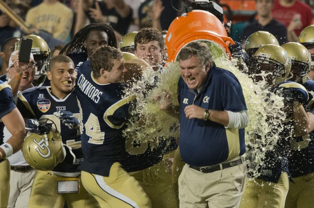 Georgia Tech head coach Paul Johnson gets dunked with Gatorade after winning the 2014 Orange Bowl win over Mississippi State. File photo by Gary I Rothstein/UPI