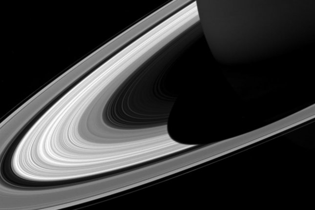 The projection of Saturn's shadow on the rings grows shorter as Saturn's season advances toward northern summer, thanks to the planet's permanent tilt as it orbits the sun. Photo by NASA/UPI