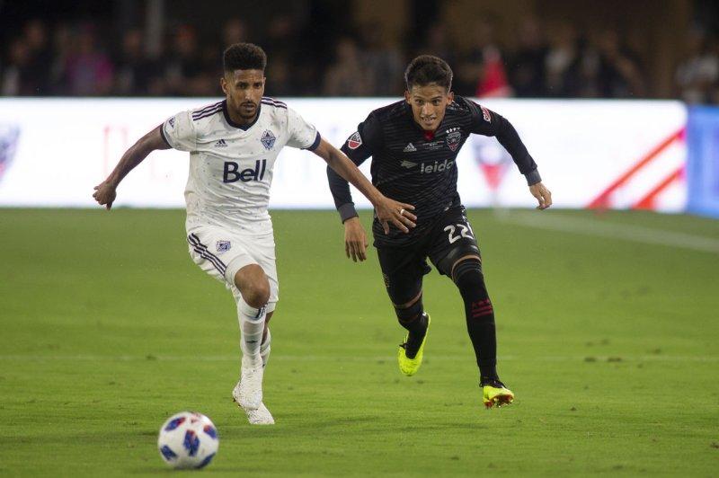 The Vancouver Whitecaps (L) had $20 million in revenue last season, while D.C. United (R) made $41 million. File Photo by Alex Edelman/UPI