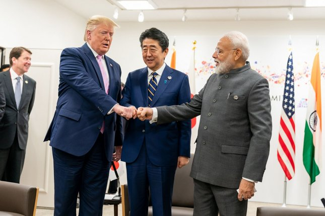 Japanese Prime Minister Shinzo Abe (C) has canceled a summit with Indian Prime Minister Narendra Modi (R) amid unrest in northeast India. File Photo by Shealah Craighead/White House