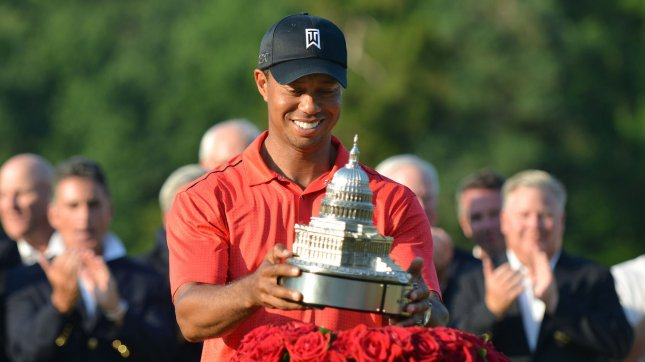 Tiger Woods picks up the trophy after winning the AT&T National at Congressional Country Club on July 1, 2012 in Bethesda, Maryland. Tiger won with eight-under-par for a four day total of 276. UPI/Kevin Dietsch