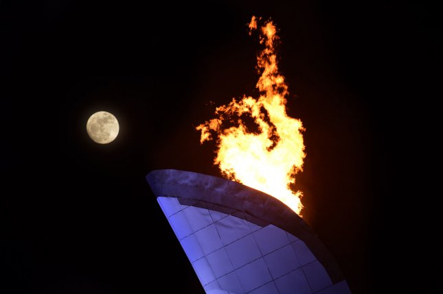 A nearly full moon rises behind the Olympic Cauldron during the 2014 Sochi Winter Olympics. A man attempted to put out the Olympic flame with a fire extinguisher as it passed through Joinville, Brazil on its way to the Summer Games. A similar attempt was made in June when a 27-year-old tossed a bucket of water near the flame, while acting on a dare. Neither attempt was successful and both men were arrested.