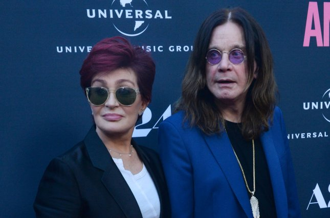 Ozzy Osbourne (R), pictured with Sharon Osbourne, postponed the U.K. and European portion of his No More Tours II tour. File Photo by Jim Ruymen/UPI