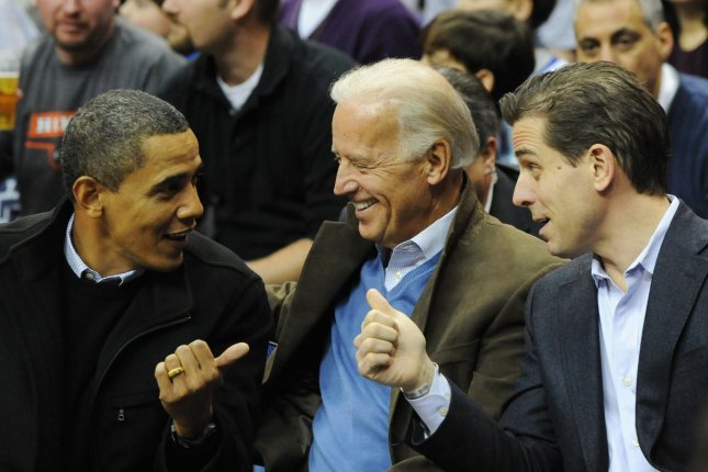 President Barack Obama (L) appears with Vice President Joe Biden (C) and his son Hunter Biden as they attend a college basketball game, Georgetown University vs Duke University, at the Verizon Center in Washington on January 30, 2010. File Photo by Alexis C. Glenn/UPI