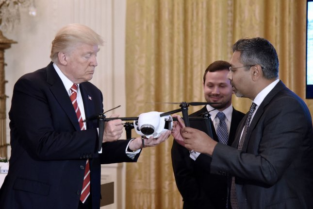 President Donald Trump holds a drone as Kespry Chairman and CEO George Mathew explains how it works during the American Leadership in Emerging Technology event in the East Room of the White House in Washington, D.C., on June 22, 2017. File Photo by Olivier Douliery/UPI