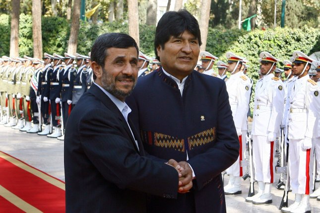 Bolivian President Juan Evo Morales is greeted by Iranian President Mahmoud Ahmadinejad (L) during official welcome ceremony at the Presidential Palace in Tehran, Iran on October 26, 2010. UPI/Maryam Rahmanian