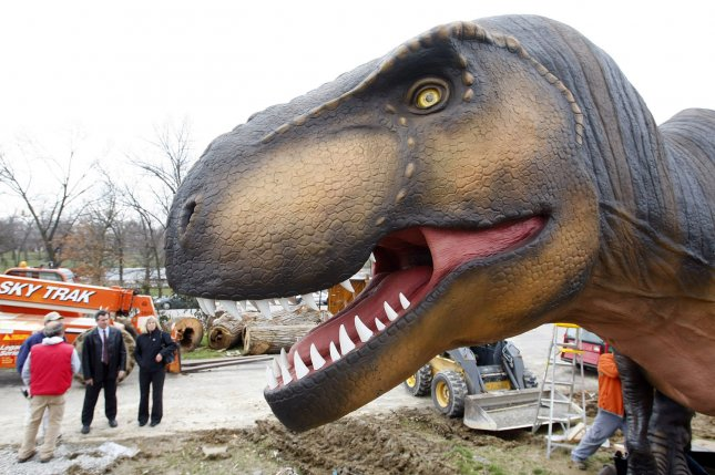 Workers set up one of the dinosaurs for a new display at the St. Louis Zoo on April 1, 2008. Some of the sixteen life-size animatronic dinosaurs that will entertain visitors through September include Tyrannosaurus rex, Triceratops, Dilophosaurus, Stegosaurus, and some baby dinosaurs. (UPI Photo/Bill Greenblatt)