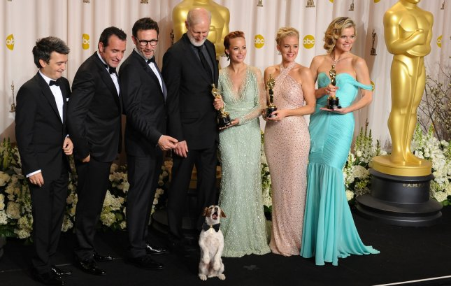 The cast of The Artist appears backstage after garnering the Best Picture trophy at the 84th Academy Awards at the Hollywood and Highland Center in Los Angeles on February 26, 2012. UPI/Jim Ruymen