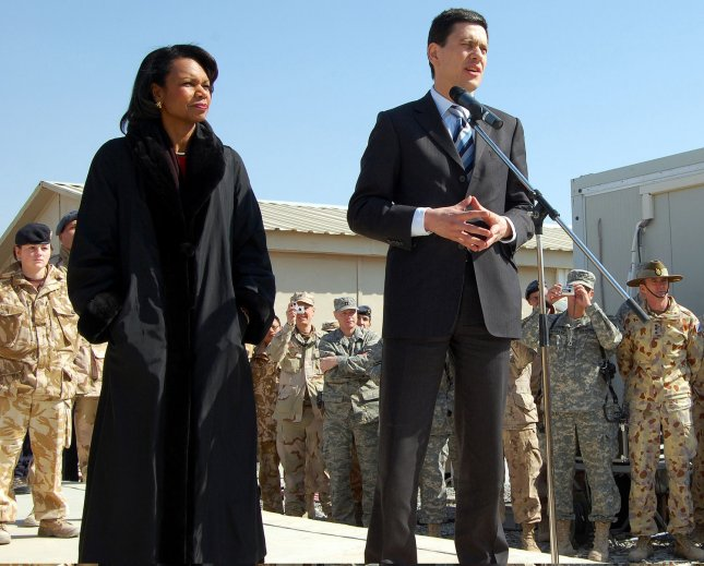 Secretary of State Condoleezza Rice (L) and British Foreign Secretary David Miliband speak to multinational troops on Kandahar Airfield in Kandahar, Afghanistan on February 7, 2008. Rice and Miliband are visiting the area to meet with troops, military leaders and top government officials. (UPI Photo/Steven Park/U.S. Navy)