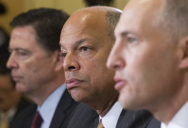 Left to right, James Comey, director of the Federal Bureau of Investigation, Homeland Security Secretary Jeh Johnson, and Matthew Olsen, director of the National Counterterrorism Center, testify during a House Homeland Security Committee hearing on Worldwide Threats to the Homeland, on Capitol Hill in Washington, D.C. on September 17, 2104. UPI/Kevin Dietsch