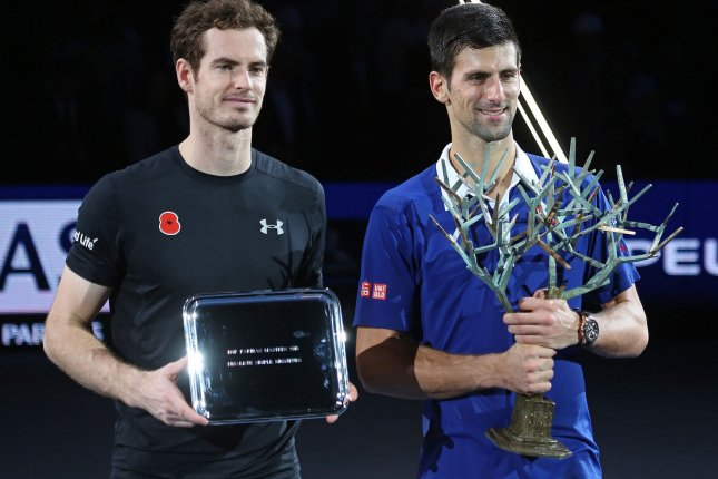 Andy Murray (L) of Great Britain and Novak Djokovic of Serbia hold their respective trophies after their finals match at the BNP Paribas Masters in Paris on November 8, 2015. Djokovic defeated Murray 6-2, 6-4 to win his fourth Masters title in Paris. Photo by David Silpa/UPI