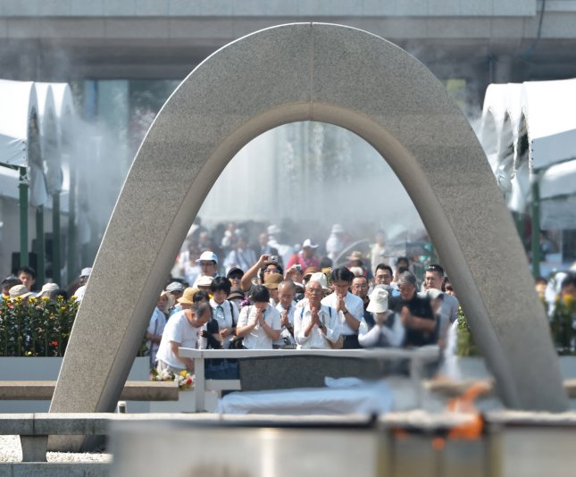People pray for the atomic bomb victims at Hiroshima Peace Memorial Park marking the 70th anniversary of the atomic bombing in Hiroshima, Japan, on August 6, 2015. File Photo by Keizo Mori/UPI