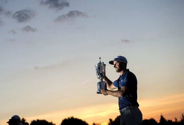 Dustin Johnson, shown here with the U.S. Open Championship Trophy at Oakmont Country Club in June, is a favorite at WGC-Mexico. Kevin Dietsch/UPI