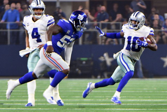Dallas Cowboys wide receiver Tavon Austin eludes New York Giants defender Alec Ogletree after a short catch during the first half on September 16 at AT&T Stadium in Arlington, Texas. Photo by Ian Halperin/UPI