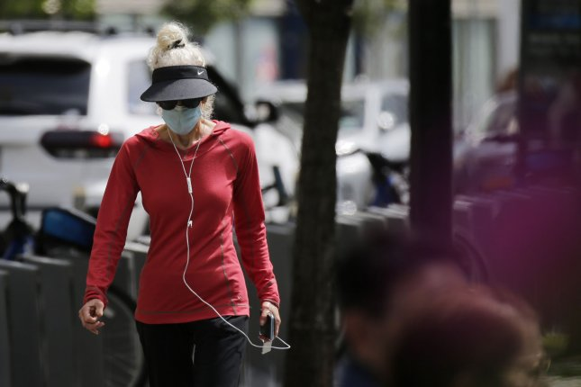A woman wears a protective face covering while walking in the Upper West Side of Manhattan during the COVID-19 pandemic in New York City on May 27. Photo by John Angelillo/UPI