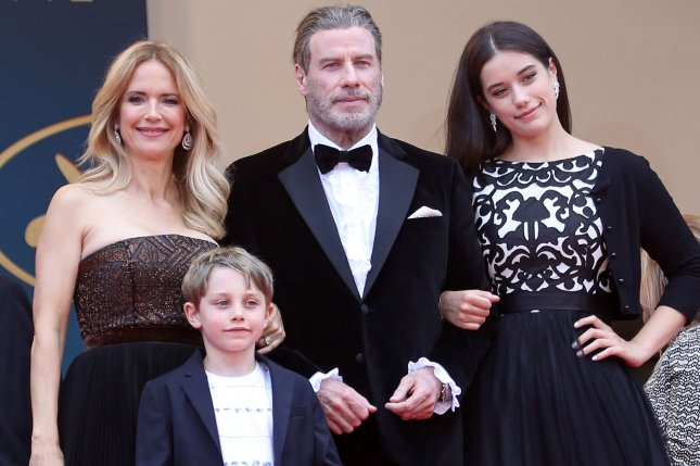 (L-R) Kelly Preston, Ben Travolta, John Travolta and Ella Travolta arrive before the screening of Solo: A Star Wars Story in Cannes in 2018. Travolta shared a video of his family celebrating their first Christmas without Preston, who died of cancer in July. File Photo by David Silpa/UPI