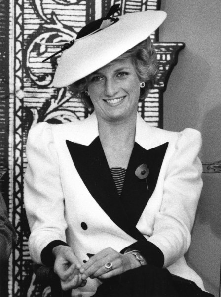 Princess Diana responds to reporters' questions after she and her husband Prince Charles toured the National Gallery of Art on November 10, 1985. The royal couple viewed a special exhibit entitled The Treasure Houses of Britain: Five Hundred Years of Private Patronage and Art Collecting. (UPI Photo/Doug Mills/Files)