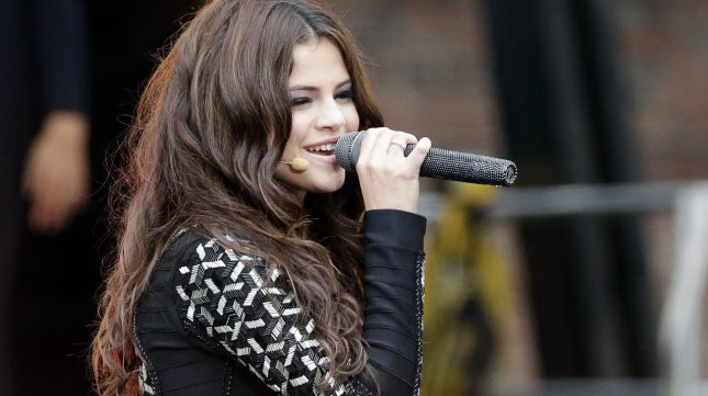 Selena Gomez performs on the Good Morning America Show in Central Park on July 26. Amid a world tour, new single releases and an acting career, Gomez still plans to release an album next year. UPI/John Angelillo