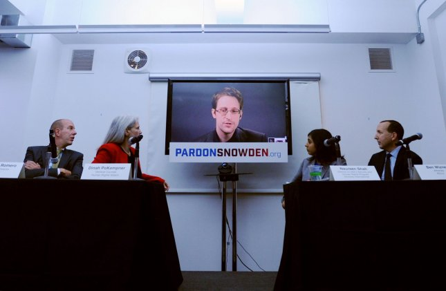 Edward Snowden speaks at a conference via a monitor at the launch of a campaign calling on President Obama to pardon him before he leaves office on September 14, 2016 in New York City. Speakers include Edward Snowden via video from Moscow, ACLU Executive Director Anthony Romero, Human Rights Watch General Counsel Dinah PoKempner, Amnesty International Director of USA's Security and Human Rights Program Naureen Shah, and Snowden's ACLU attorney Ben Wizner. Photo by Dennis Van Tine/UPI