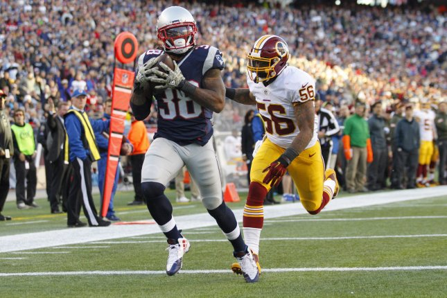 New England Patriots running back Brandon Bolden (38) pulls in an 18-yard touchdown reception while Washington Redskins linebacker Perry Riley, Jr. (56) gives chase. File photo by Matthew Healey/ UPI