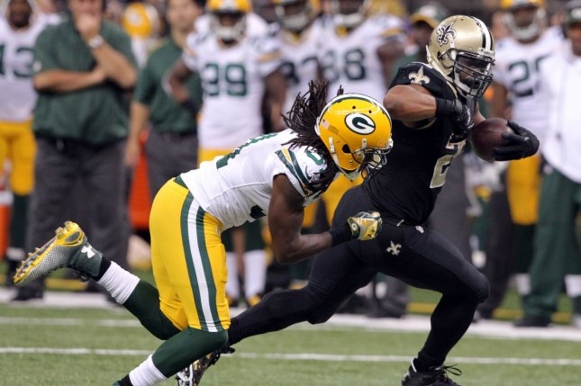 New Orleans Saints running back Mark Ingram (22) tries to out run Green Bay Packers cornerback Davon House (31). File photo by A.J. Sisco/UPI