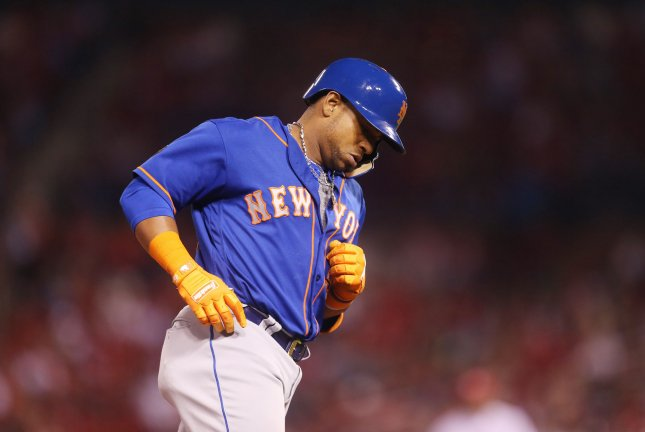 New York Mets' Yoenis Cespedes touches third base after hitting a three run home run in the fifth inning against the St. Louis Cardinals Tuesday at Busch Stadium in St. Louis, Mo. Photo by Bill Greenblatt/UPI