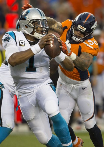 Denver Broncos linebacker Shane Ray closes in on Carolina Panthers quarterback Cam Newton during a game in 2016. Photo by Gary C. Caskey/UPI