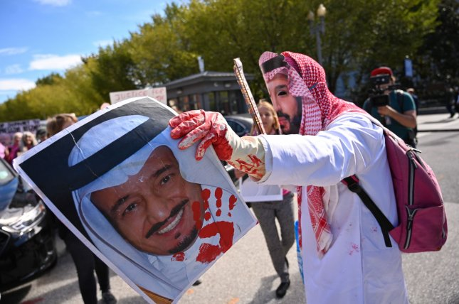 A protester dressed as Saudi Crown Prince Mohammed bin Salman demonstrates in Washington, D.C., October 19 to call attention to the death of slain journalist Jamal Khashoggi. Photo by Kevin Dietsch/UPI