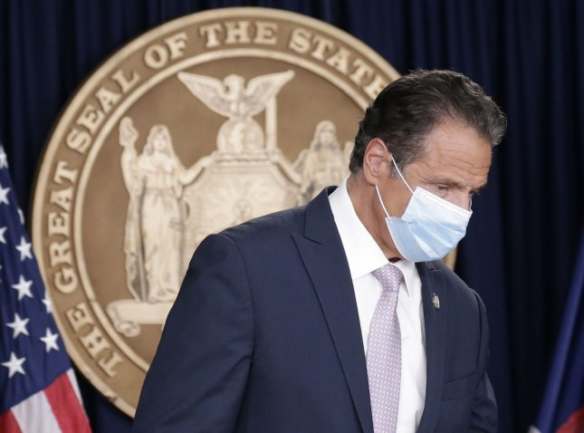 New York Governor Andrew Cuomo enters wearing a face mask when he holds a briefing Monday related to the coronavirus in New York City. Photo by John Angelillo/UPI