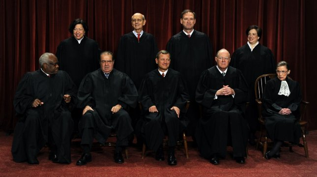 The Supreme Court Justices of the United States sit for a formal group photo in the East Conference Room of the Supreme Court in Washington on October 8, 2010. The Justices are (front row from left) Clarence Thomas, Antonin Scalia, John G. Roberts (Chief Justice), Anthony Kennedy, Ruth Bader Ginsburg; (back row from left) Sonia Sotomayor, Stephen Breyer, Sameul Alito and Elena Kagan, the newest member of the Court. UPI/Roger L. Wollenberg