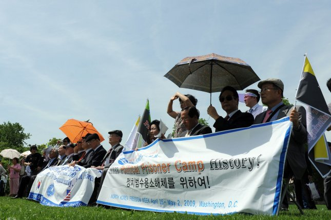 Demonstrators participate in a North Korean Freedom and Human Rights rally on Capitol Hill in Washington on April 28, 2009. (UPI Photo/Roger L. Wollenberg)