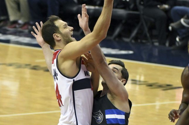 Washington Wizards guard Bojan Bogdanovic (44) scores against Orlando Magic guard Mario Hezonja (8) in the first half at the Verizon Center in Washington, D.C. on March 5, 2017. Photo by Mark Goldman/UPI