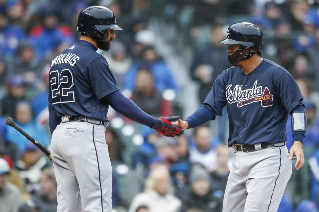 Atlanta Braves catcher Kurt Suzuki (R) celebrates with Atlanta Braves right fielder Nick Markakis (L) after scoring against the Chicago Cubs in the fifth inning of a baseball game on April 13 at Wrigley Field in Chicago. Photo by Kamil Krzaczynski/UPI