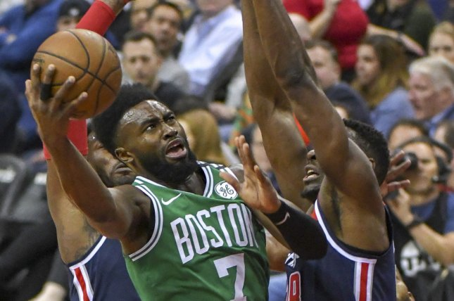 Boston Celtics guard Jaylen Brown (7) scores against Washington Wizards center Ian Mahinmi (28) in the first half on April 10 at Capital One Arena in Washington, D.C. Photo by Mark Goldman/UPI