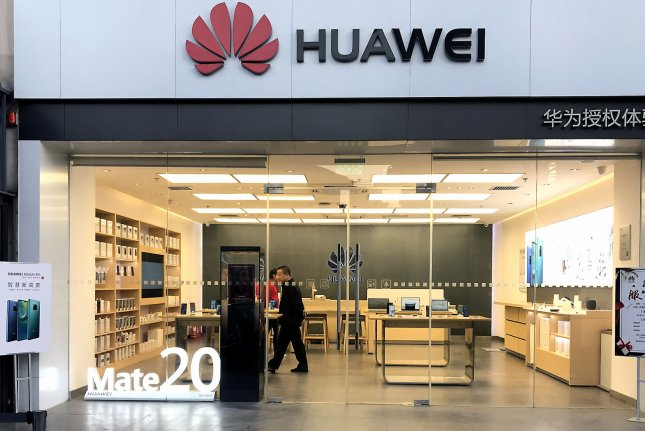 A Chinese man shops in a Huawei computer and smartphone showroom in Beijing on December 10. Photo by Stephen Shaver/UPI