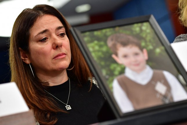 Francine Wheeler, mother of Ben Wheeler, 6, who was killed in the 2013 Sandy Hook Elementary School shooting, listens as she sits behind a photo of her son during a Senate hearing on gun violence last year. File Photo by Kevin Dietsch/UPI