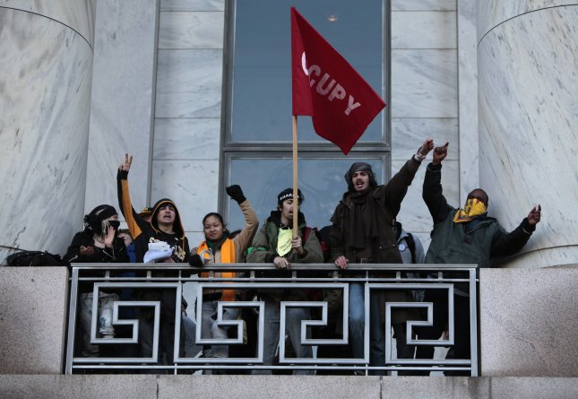 Occupy Congress protesters rally on the balcony of the Rayburn House office building on Capitol Hill in Washington on January 17, 2012. UPI/Yuri Gripas.