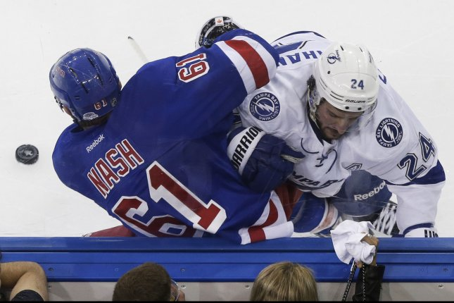 Tampa Bay Lightning's Ryan Callahan forces New York Rangers' Rick Nash into the boards in game 7 in the Eastern Conference Finals of the Stanley Cup Playoffs at Madison Square Garden in New York City on May 29, 2015. Photo by John Angelillo/UPI
