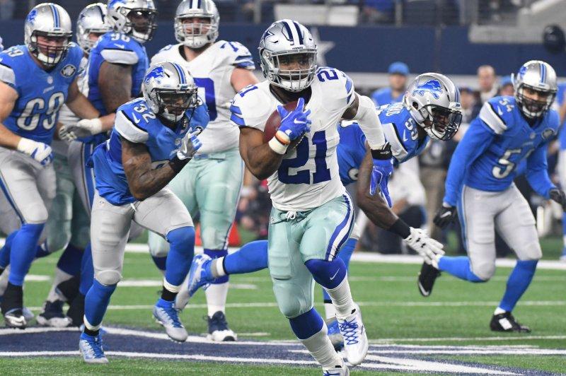 Dallas Cowboys Ezekiel Elliott scores on a 55-yard touchdown against the Detroit Lions during the first half at AT&T Stadium in Arlington, Texas on December 26, 2016. Ian Halperin/UPI