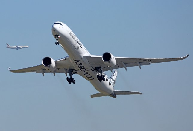 An Airbus A350-1000 aircraft takes off at the Paris Air Show on Monday. Airbus SAS announced orders and agreements for the sale of $39.7 billion of planes at the show, including 73 planes sold to two Iranian domestic airlines. Photo by David Silpa/UPI