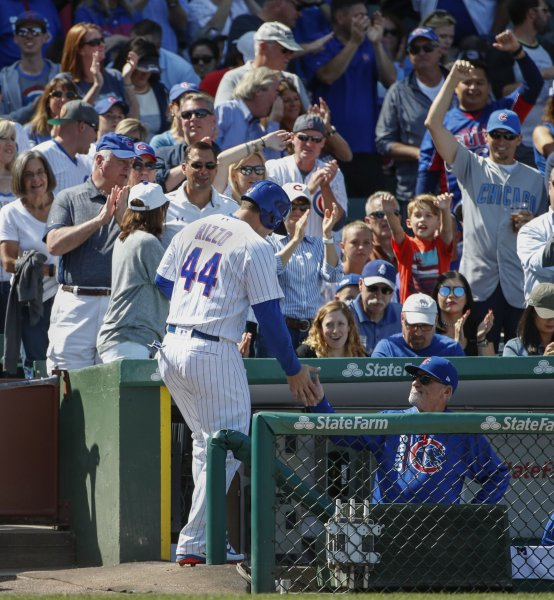 Chicago Cubs' Anthony Rizzo celebrates with manager Joe Maddon after scoring against the Atlanta Braves on Friday at Wrigley Field. Photo by Kamil Krzaczynski/UPI