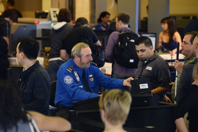 Passengers are processed by TSA screeners at Los Angeles International Airport on November 2, 2013. This week, the ACLU filed a lawsuit against the TSA to get information released about its policy on electronic device searches. File Photo by Jim Ruymen/UPI