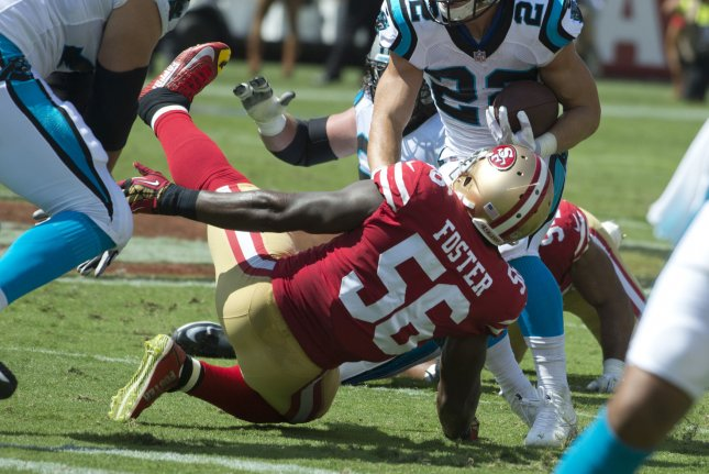 San Francisco 49ers first-round draft choice linebacker Reuben Foster (56) twists his ankle tackling Carolina Panthers running back Christian McCaffrey (22) in the first quarter on September 10, 2017 at Levi's Stadium in Santa Clara, California. Photo by Terry Schmitt/UPI