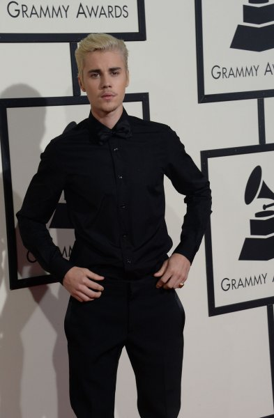 Singer Justin Bieber proposed via Twitter a fight with film star Tom Cruise. File Photo by Jim Ruymen/UPI
