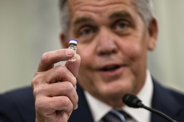 Wesley Wheeler, president of Global Healthcare at United Parcel Service, displays a sample COVID-19 vaccine vial during a Senate hearing Thursday. Photo by Samuel Corum/UPI/Pool