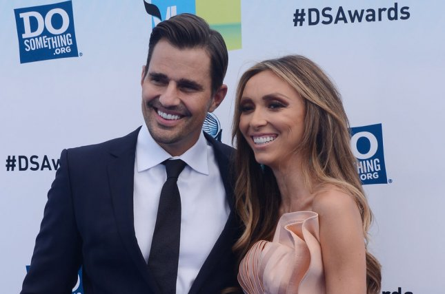 TV Personalities Bill Rancic and Giuliana Rancic arrive for the Do Something Awards at Barker Hangar in Santa Monica, California on August 19, 2012. UPI/Jim Ruymen