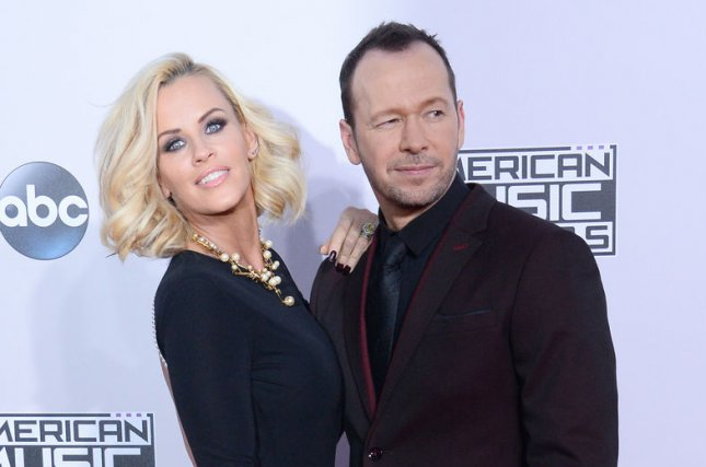 Jenny McCarthy, left, and Donnie Wahlberg arrive for the 42nd annual American Music Awards held at Nokia Theatre L.A. Live in Los Angeles on November 23, 2014. McCarthy recently dyed her hair hot pink because she's still at that age where I can get away with it for like a month. Photo by Jim Ruymen/UPI