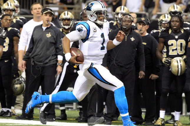 63fe79f97fa Carolina Panthers quarterback Cam Newton (1) keeps the ball for a 30 yard  gain against New Orleans Saints during the first quarter at the  Mercedes-Benz ...