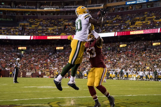 Green Bay Packers Martellus Bennett brings in a touchdown pass against Washington Redskins Zach Brown in the first quarter of their pre-season game at FedEx Field in Landover, Maryland on August 19, 2017. File photo by Kevin Dietsch/UPI