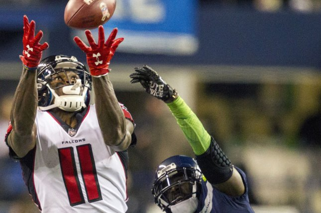 Atlanta Falcons wide receiver Julio Jones (11) hauls in a pass for a 21-yard gain against Seattle Seahawks cornerback Jeremy Lane (20) in the second quarter at CenturyLink Field in Seattle, Washington on November 20, 2017. The Atlanta Falcons hang on to beat the Seattle Seahawks 34-31 in Seattle. Photo by Jim Bryant/UPI